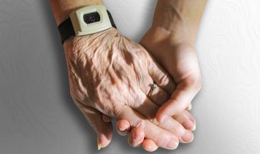 Model of Elderly person receiving a hand reflexology treatment